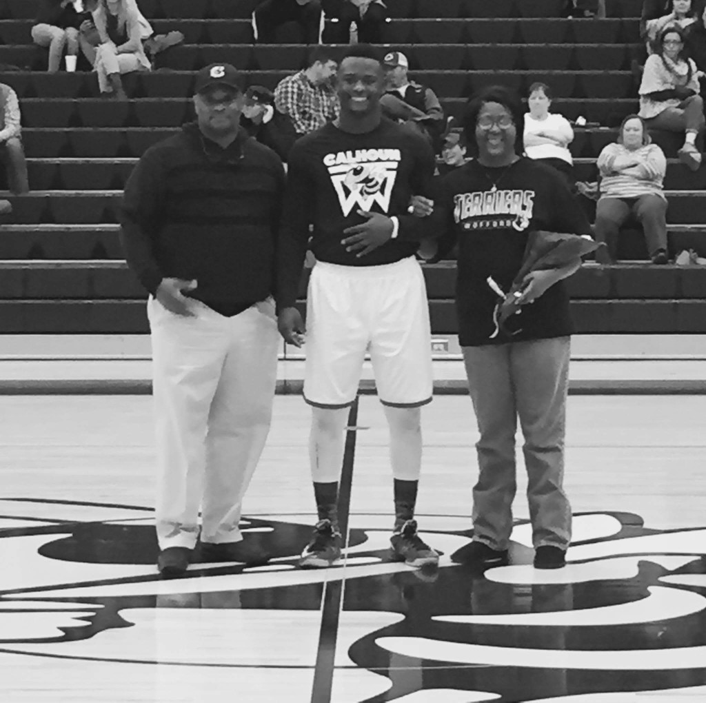 Jireh with parents Jackie and Tera Wilson.  2016 Senior Nite