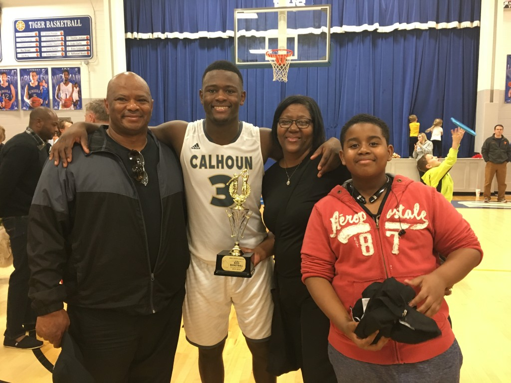 Jireh Wilson with parents and cousin Jay Fife